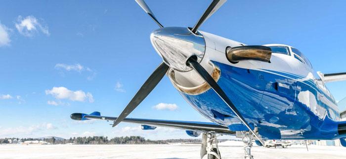 Pilatus aircraft at rest on snowy-tarmac